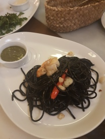Crab with squid ink spaghetti